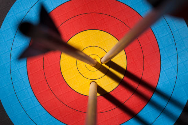 three arrows on an archery target - sports target stock photos and pictures