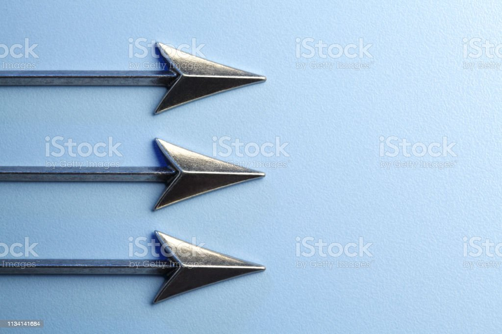 Three Arrows Pointing In The Same Direction stock photo