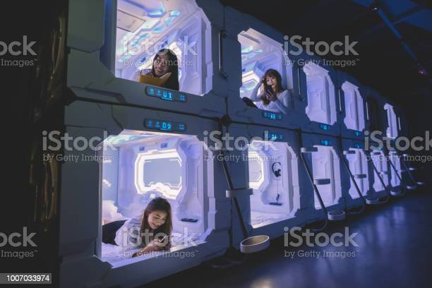 Three asian chinese female tourist check in capsule hotel room and picture id1007033974?b=1&k=6&m=1007033974&s=612x612&h=ko0xe bbsrh1qmzvj3hpov ubqqdcc9syzz1ud1 43i=