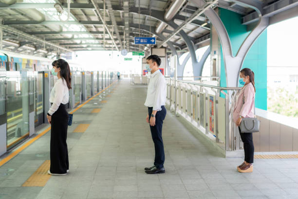 three asian people wearing mask standing distance of 1 meter from other people keep distance protect from covid-19 viruses and people social distancing  for infection risk and disease prevention measures. - social distancing stock pictures, royalty-free photos & images