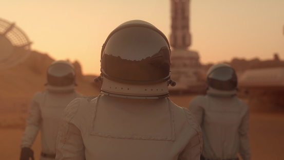 Three Astronauts in Space Suits Confidently Walking on Mars. Mars Colonization Concept. 3d rendering.