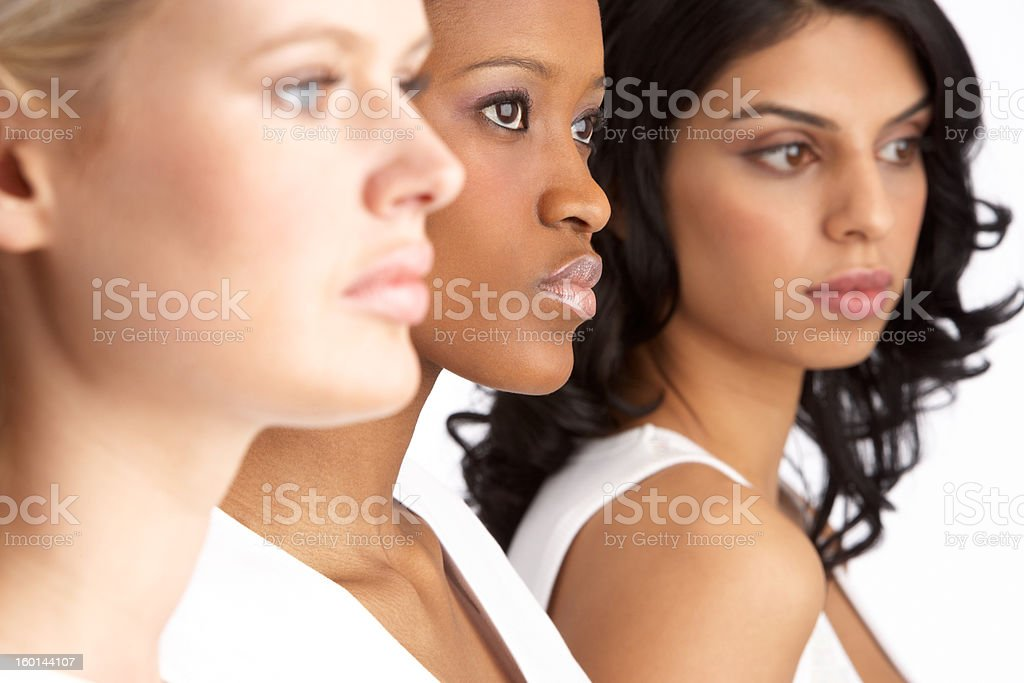 Three Attractive Young Women Standing In A Line stock photo