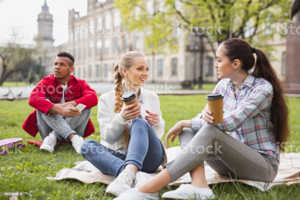 Three bachelor students enjoying coffee break together zbiór zdjęć royalty-free