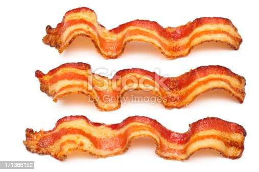 Wavy slices of freshly cooked bacon