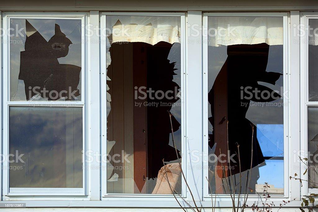 Three Badly Broken Windows stock photo