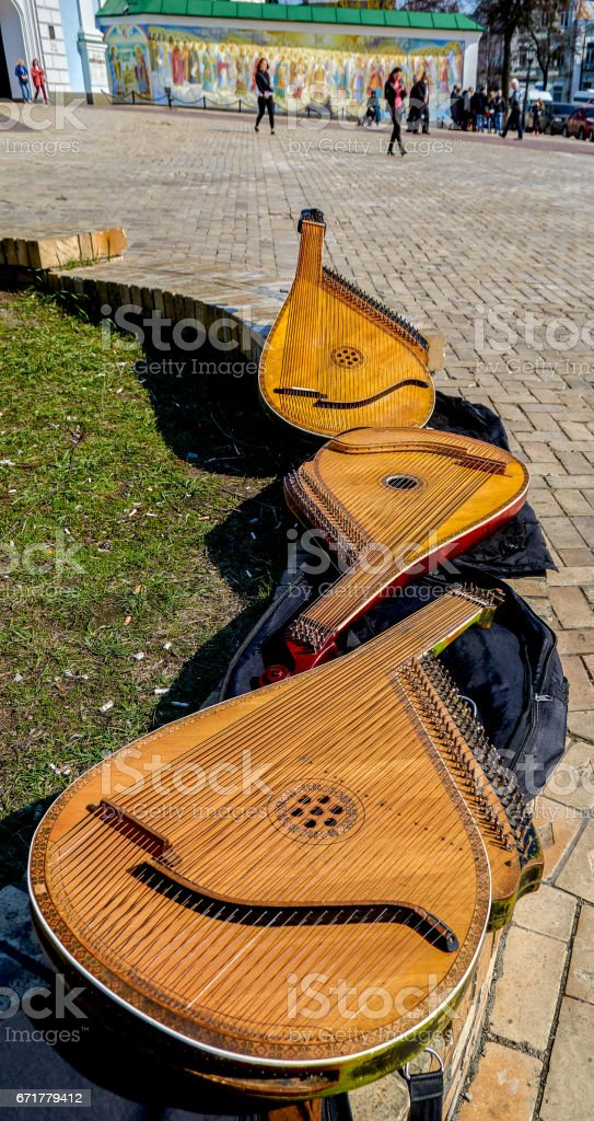 Three bandura (pandora) on the bench стоковое фото
