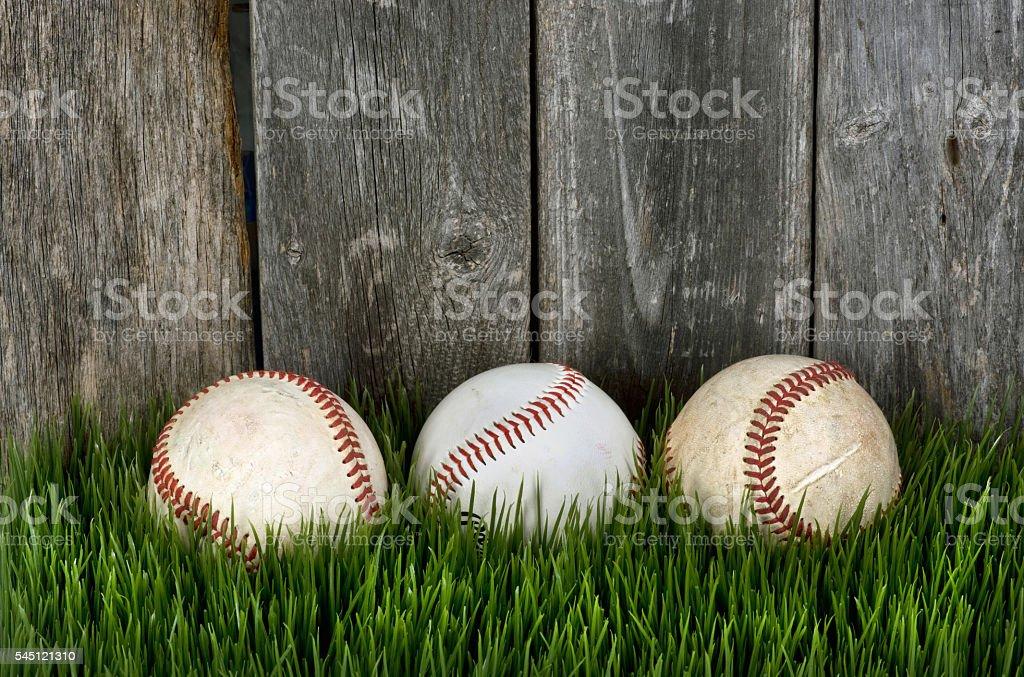 Three Baseballs on grass. stock photo