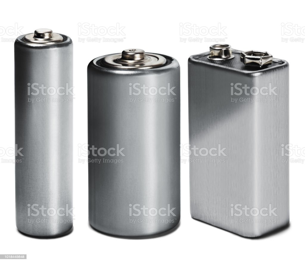 Three batteries AAA, AA and PP3 on white isolated background. Concept of renewable energy and sources of electrical power. Pattern for designer of environmental power sources, electrical power sources. stock photo