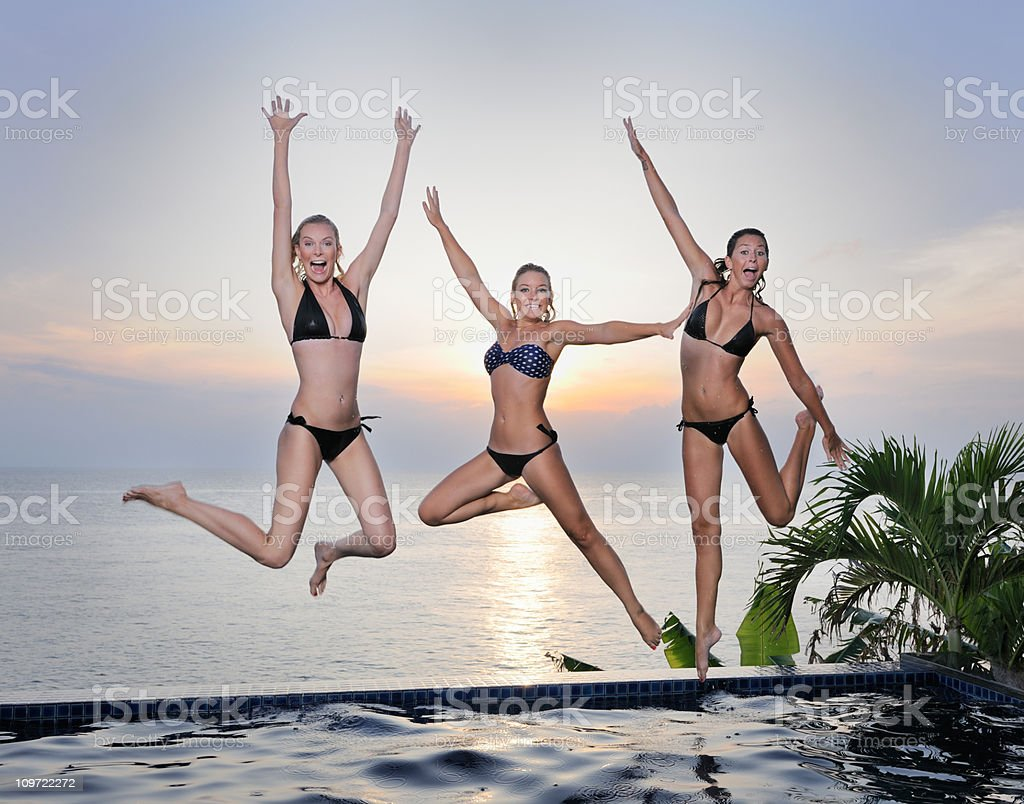 Three Beauties jumping at Sunset (XXXL) royalty-free stock photo