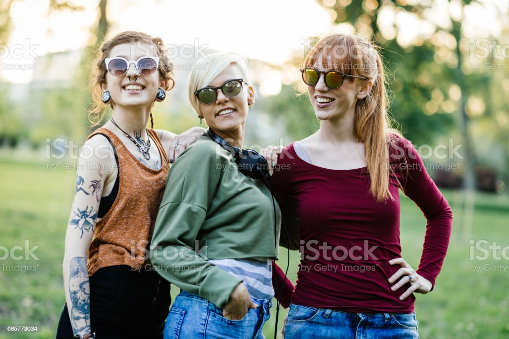Three beautiful but different girls posing together in park royalty-free stock photo
