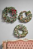 istock Three Beautiful festive wreaths of fresh spruce on the gray wall. Christmas mood. Xmas tree. 1192404611