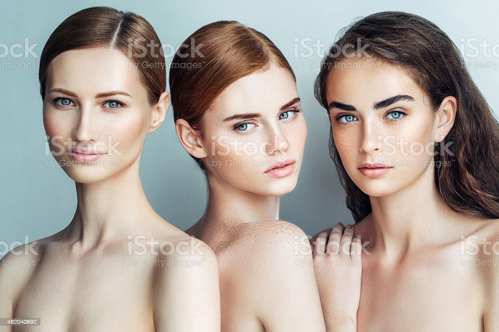 Three beautiful girls with a natural make-up stock photo
