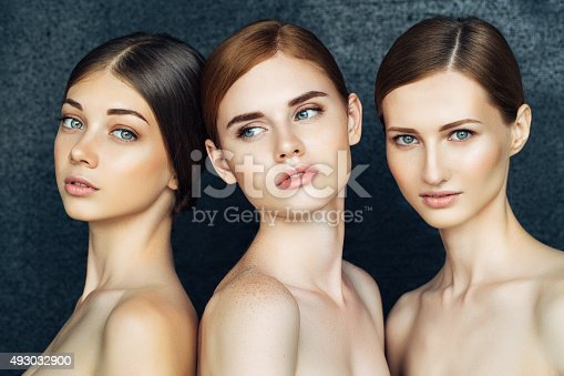 istock Three beautiful girls with a natural make-up 493032900