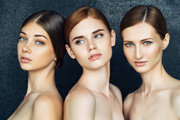 three beautiful girls with a natural make-up - three people stock photos and pictures