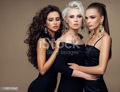 564586660istockphoto Three beautiful girls with make-up and hairstyle 1133210242