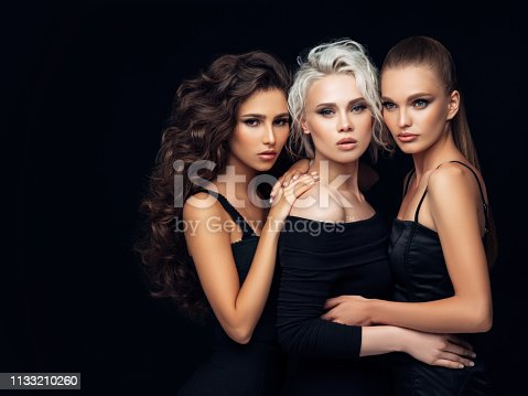 564586660istockphoto Three beautiful girls with make-up and hairstyle 1133210260