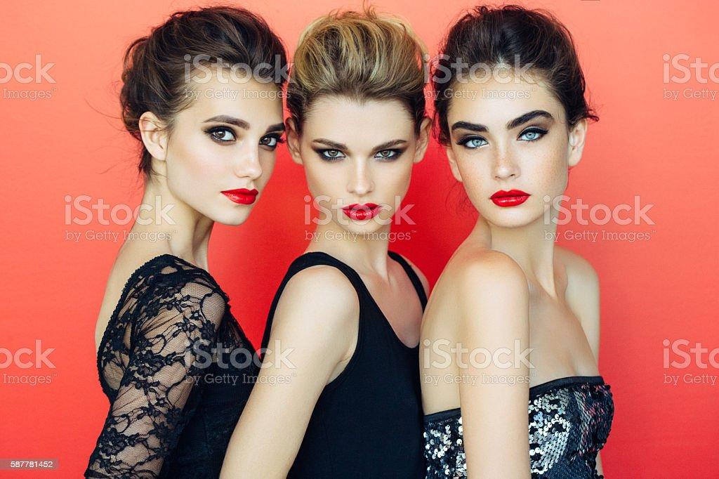 Three beautiful girls with make-up stock photo
