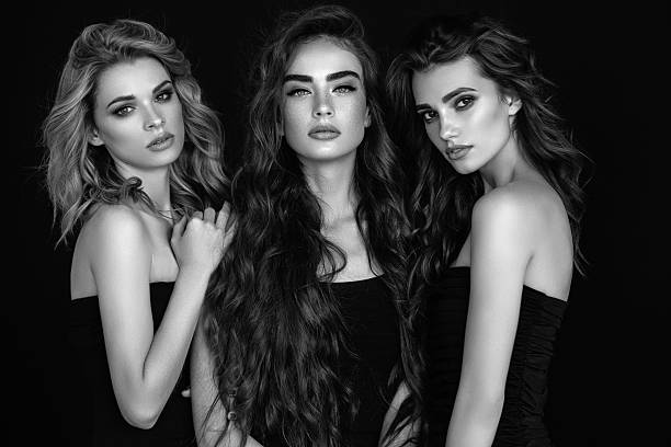 Three beautiful girls with perfect hair and make-up stock photo