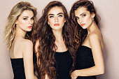 Three beautiful girls with perfect hairstyle and make-up