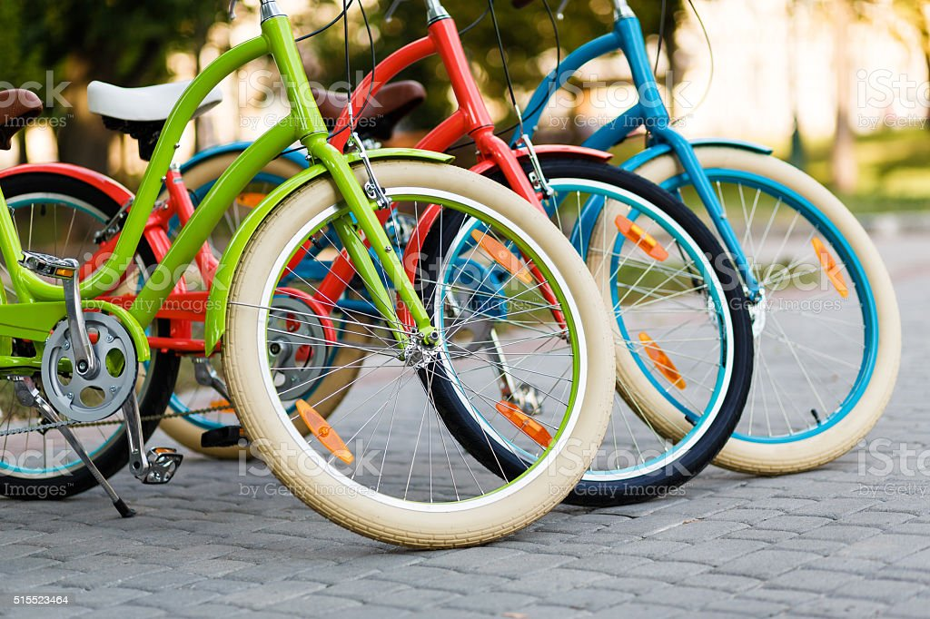 Three beautiful lady city bikes. stock photo