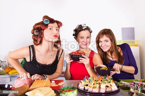 Three Beautiful Young Women Housewifes Cook Together Stock Photo & More Pictures of 2015