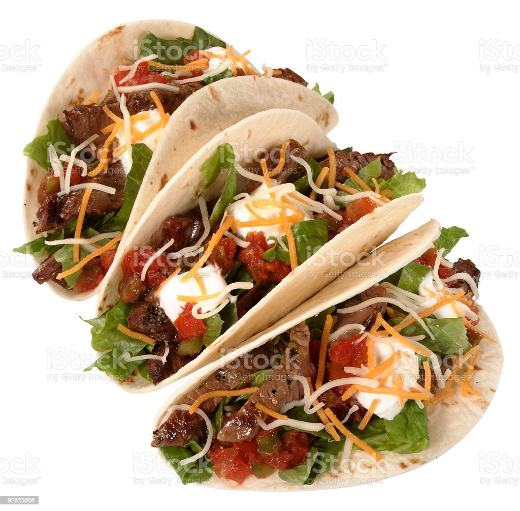 Three beef tacos on a white background stock photo