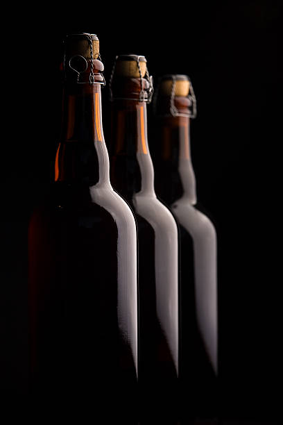 Three Beer Bottles Corked stock photo
