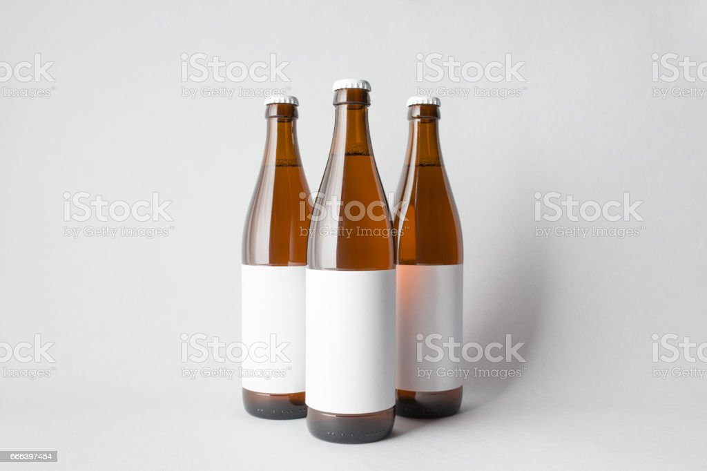 Three beer bottles on the scene, mock-up. stock photo