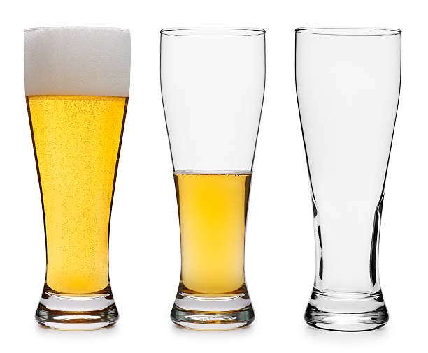 three beer glasses in various stages - beer glass stock photos and pictures