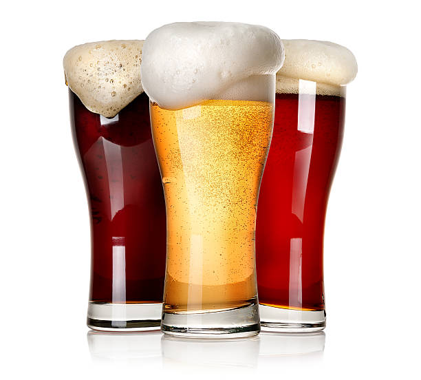 three beers isolated - beer pour stock photos and pictures