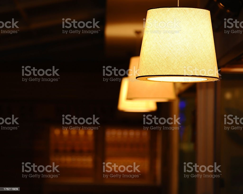 Three beige lamps on a wood background stock photo