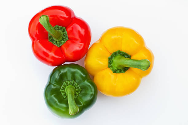 three bell peppers in different colors stock photo