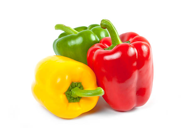 three bell peppers three bell peppers isolated on white background yellow bell pepper stock pictures, royalty-free photos & images