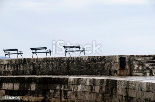 472923810 istock photo Three benches on a sea wall 175409403