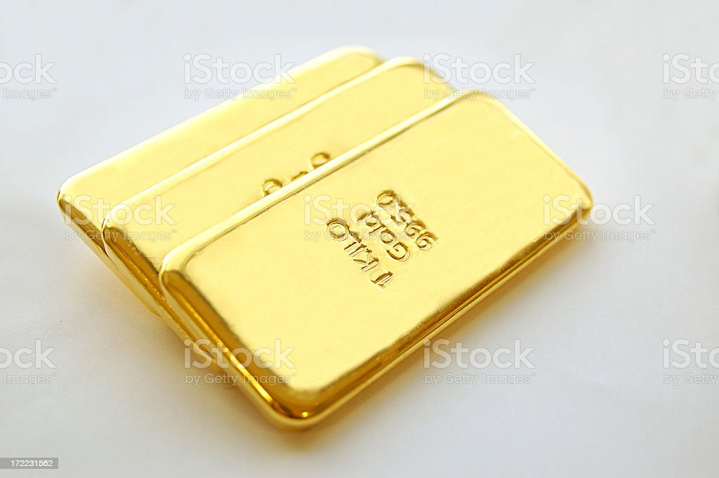 Three big gold bars with a white background  royalty-free stock photo