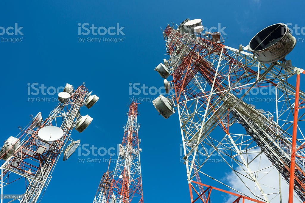 three big radio mast with blue sky stock photo