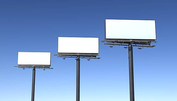 three billboards isolated against blue sky - three objects stock pictures, royalty-free photos & images