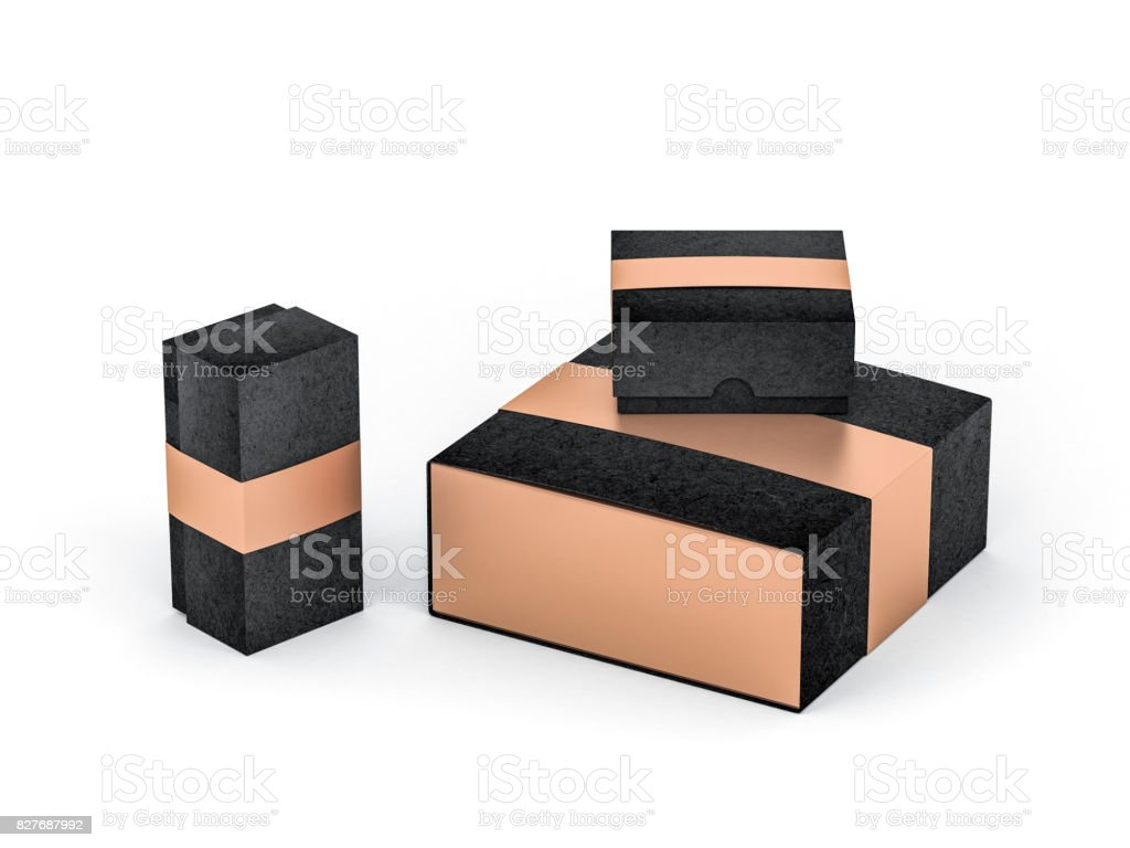 Three black boxes with golden label in white studio stock photo
