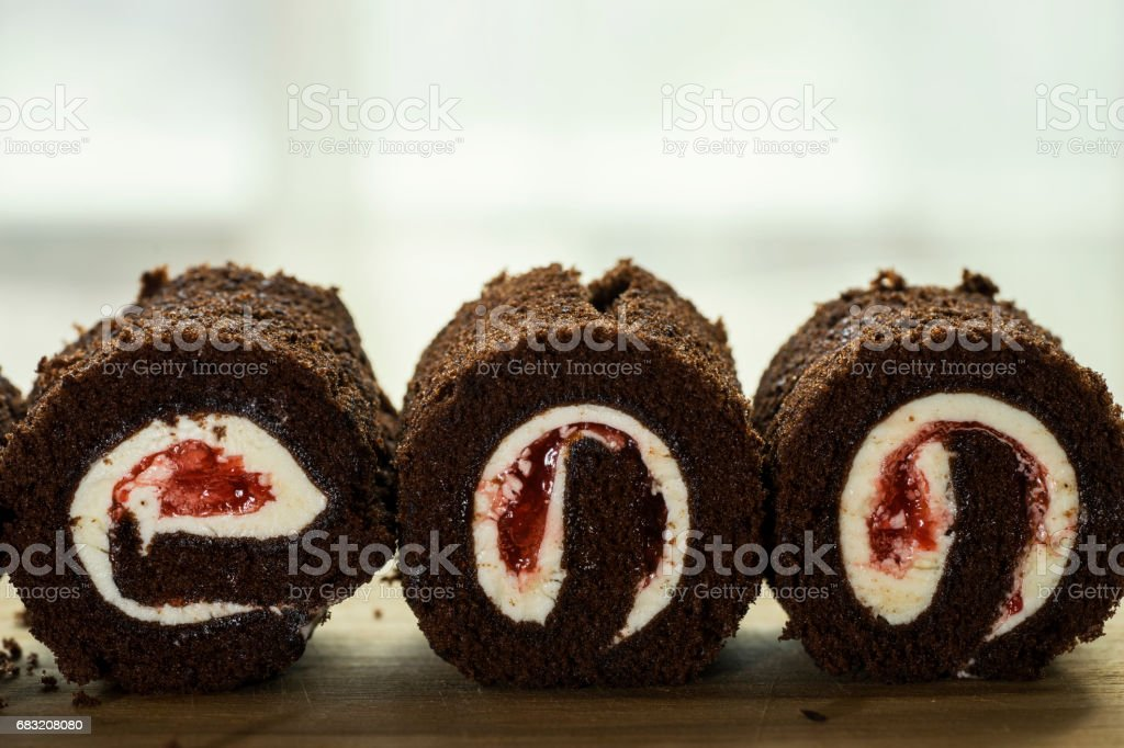 three black forest cake roll face cut on wood 免版稅 stock photo