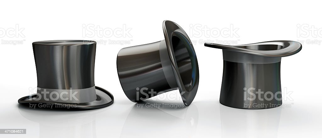 Three black top hats isolated on white background stock photo