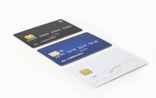 Three blank credit cards in a row on white background stock photo