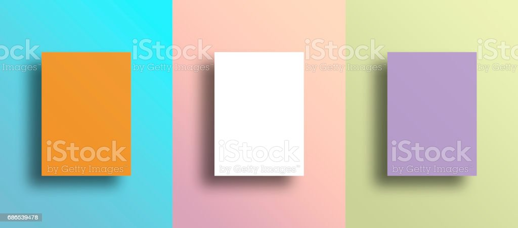 Three blank frames on multi colored wall stock photo