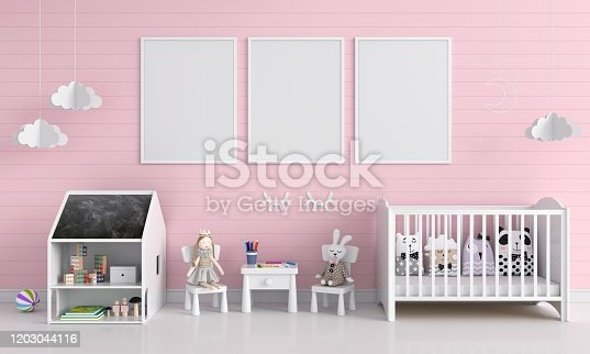 619975932 istock photo Three blank photo frame for mockup in pink child room 1203044116