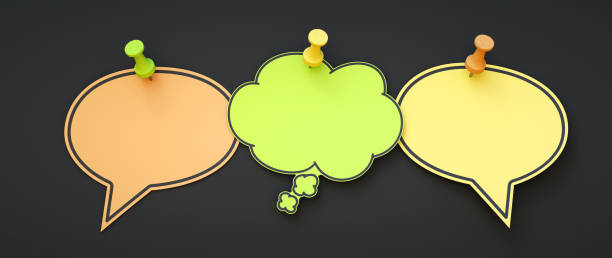 Three blank speech bubble notes side by side with copy space pinned to a dark background. Designed for additional composition. stock photo