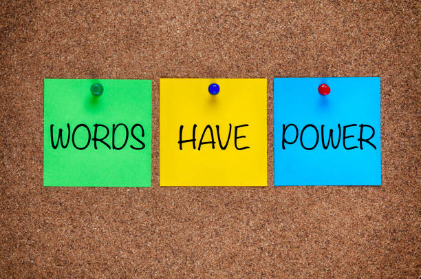 Three blanks post-it notes with phrase Words Have Power on corkboard. Three blanks post-it notes with phrase Words Have Power on corkboard. single word stock pictures, royalty-free photos & images