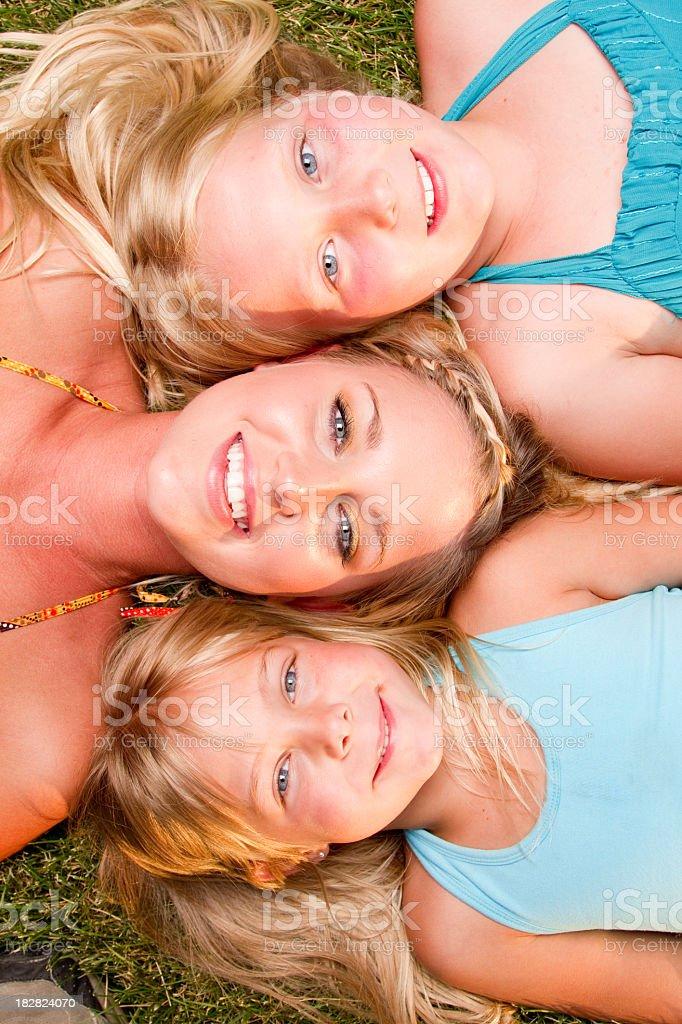 Three Blond Girls Lying Down royalty-free stock photo