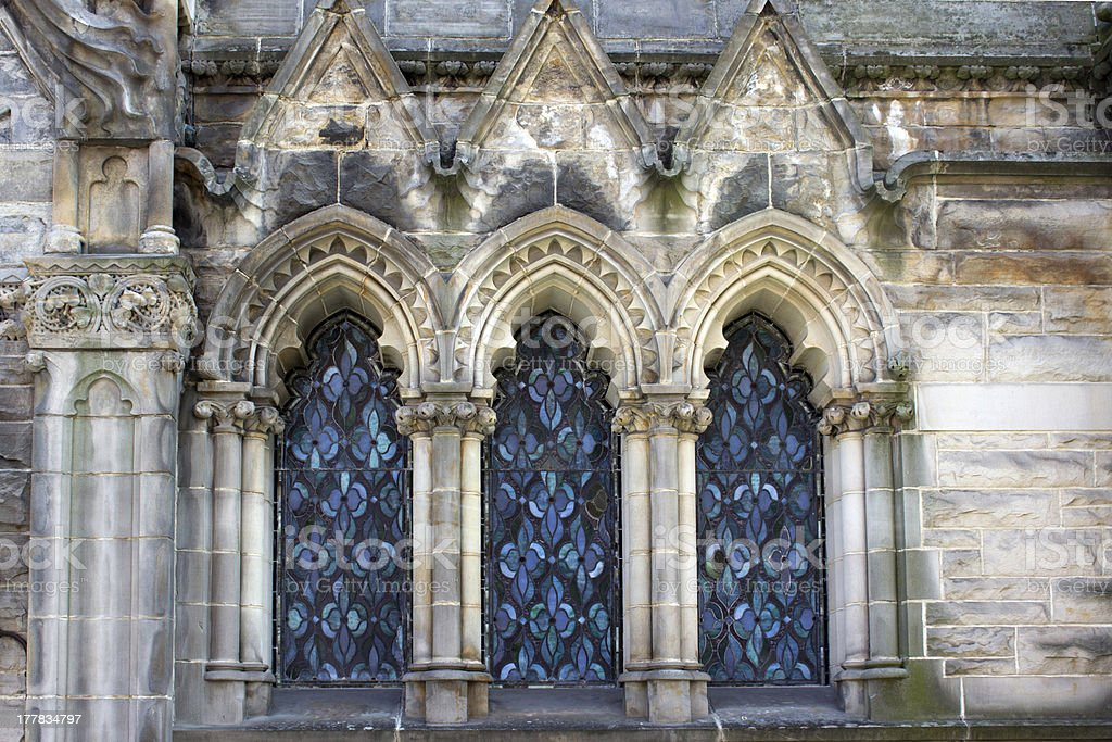 Three Blue Arched Stained Glass Windows stock photo