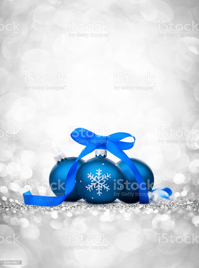 Three blue bauble with ribbon, christmas tree decoration and glitter stock photo