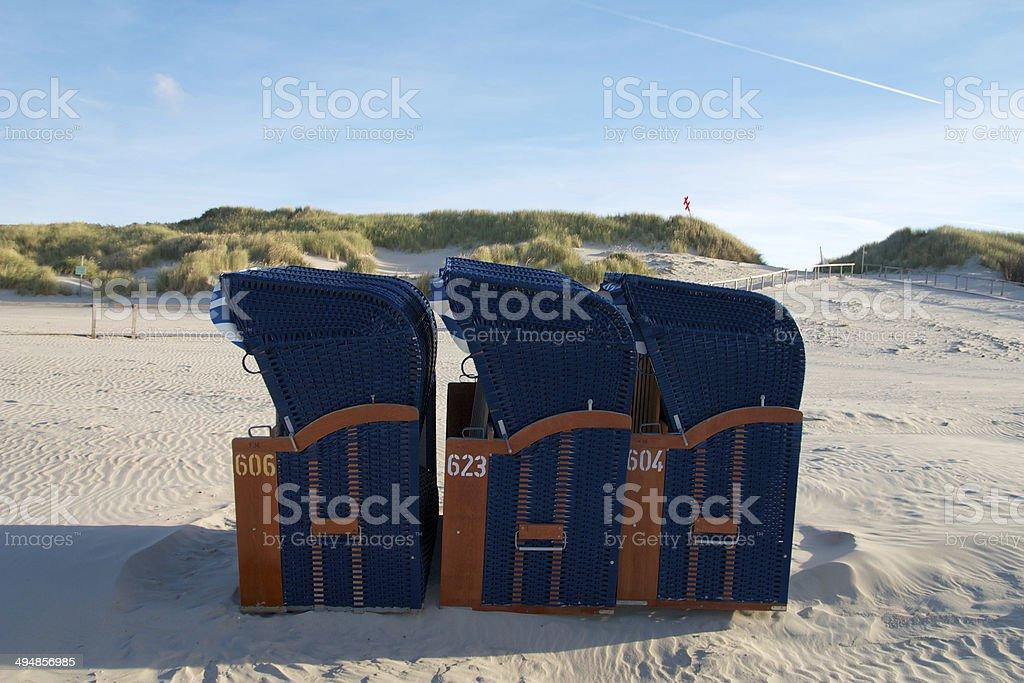 Drei blaue Strandkörbe auf Juist stock photo