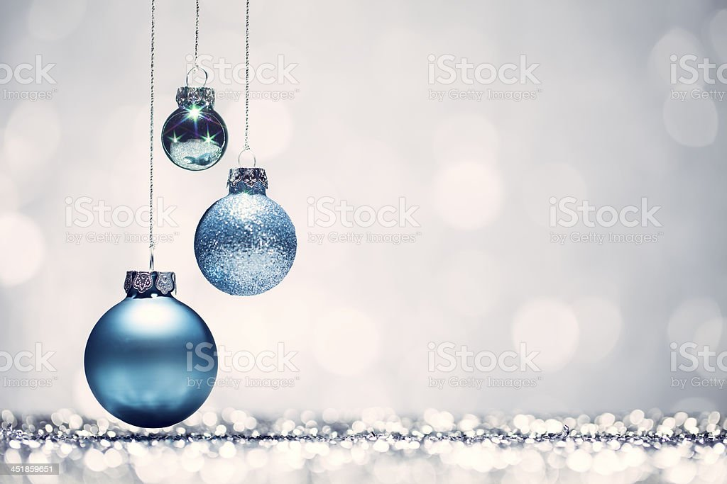 Three blue Christmas baubles with white background stock photo